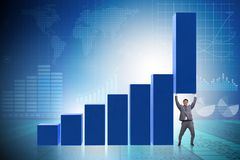 The businessman supporting growtn in economy on chart graph Royalty Free Stock Image
