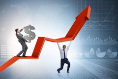 The businessman supporting growtn in economy on chart graph. Businessman supporting growtn in economy on chart graph Royalty Free Stock Images