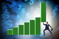 The businessman supporting growtn in economy on chart graph. Businessman supporting growtn in economy on chart graph Royalty Free Stock Photo