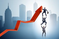 The businessman supporting growtn in economy on chart graph Stock Photos
