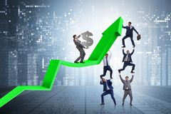 The businessman supporting growtn in economy on chart graph. Businessman supporting growtn in economy on chart graph Stock Photos