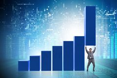 The businessman supporting growtn in economy on chart graph. Businessman supporting growtn in economy on chart graph Stock Image