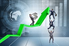 The businessman supporting growtn in economy on chart graph. Businessman supporting growtn in economy on chart graph Stock Images