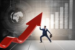 The businessman supporting growtn in economy on chart graph. Businessman supporting growtn in economy on chart graph Royalty Free Stock Image