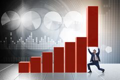 The businessman supporting growtn in economy on chart graph. Businessman supporting growtn in economy on chart graph Stock Photo