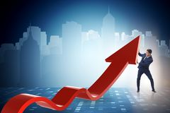 The businessman supporting growtn in economy on chart graph. Businessman supporting growtn in economy on chart graph Royalty Free Stock Photography