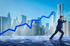 The businessman supporting increase in economy Stock Images