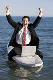 Businessman on Surfboard Stock Image
