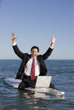 Businessman on Surfboard Royalty Free Stock Photography
