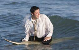 Businessman on Surfboard Stock Image