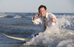 Businessman on Surfboard Royalty Free Stock Photo