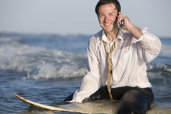 Businessman on Surfboard stock photography