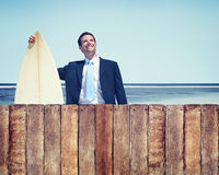 Businessman with Surfboard Beach Concept Stock Images