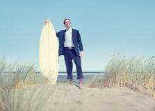 Businessman with Surfboard Standing by the Beach Stock Photography
