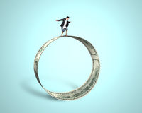 Businessman surfing and balancing on large money circle in green Stock Photo
