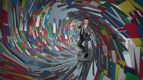 Businessman Surfing inside a Tube made of World Flags, stock footage stock footage