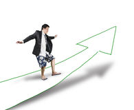 Businessman surfing on road with growth arrow Royalty Free Stock Photography