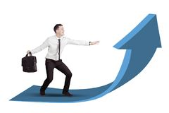 Businessman surfing on an upward arrow isolated over white background Stock Images