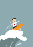 Businessman surfing on a wave of success Royalty Free Stock Photography