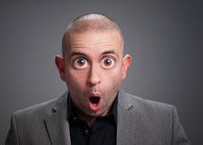 Businessman with surprise expression. The photo has a digital retouching with eyes wide open Royalty Free Stock Images