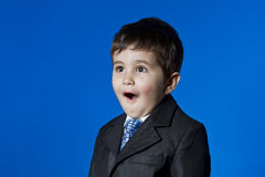 Businessman surprised, cute little boy portrait over blue chroma Stock Image