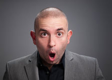 Businessman with surprised expression Royalty Free Stock Photos