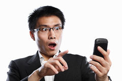 Businessman surprised when using video call Stock Image