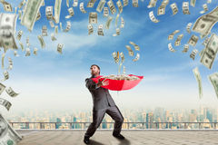 Businessman surrounded with money Royalty Free Stock Photos