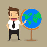 Businessman survey the world in his hands Royalty Free Stock Image