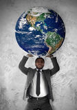 Businessman sustains the planet Earth stock photography