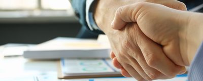 Businessman in sut hand shake in ofiice closeup. Introduce manager job man risk chart paper how deal teamwork agency employment complite finish paperwork stock photos