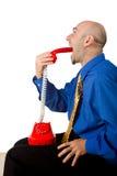 Businessman swallows phone Stock Photos