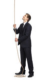 Businessman swarming up the cord Royalty Free Stock Images