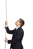 Businessman swarming up the line Royalty Free Stock Images