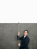 Businessman swarming up the string with white poster Royalty Free Stock Images