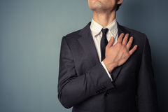 Businessman swearing allegiance Stock Image