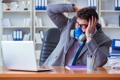 Businessman sweating excessively smelling bad in office at workp. Lace Stock Photography
