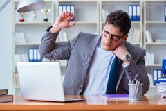 Businessman sweating excessively smelling bad in office at workp. Lace Stock Photo