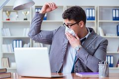 Businessman sweating excessively smelling bad in office at workp. Lace Royalty Free Stock Photo