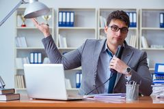 Businessman sweating excessively smelling bad in office at workp. Lace Royalty Free Stock Photography