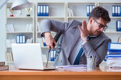 Businessman sweating excessively smelling bad in office at workp. Lace royalty free stock image