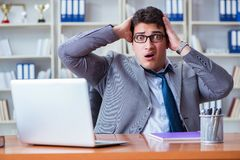 Businessman sweating excessively smelling bad in office at workp. Lace Royalty Free Stock Photos