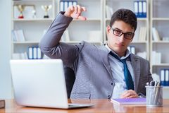 Businessman sweating excessively smelling bad in office at workp. Lace Stock Photos