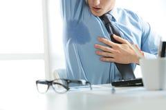 Businessman sweating
