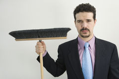Businessman sweeping Royalty Free Stock Photo