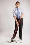 Businessman is sweeping money Stock Image