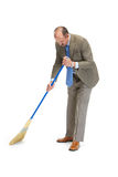 Businessman sweeps. A floor on a white background Stock Image