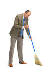Businessman sweeps. A floor on a white background Stock Photo