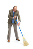 Businessman sweeps. A floor on a white background Royalty Free Stock Photos