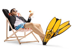 Businessman with swimming fins and cocktail Royalty Free Stock Photography
